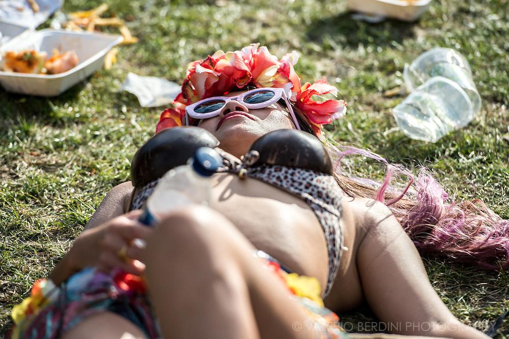 Sunbathing in hawayanas dress at Field Day festival in London Victoria Park on 8 June 2014