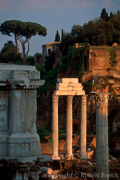 ITALY, ROME, ROMAN FORUM view toward the three columns of the Temple of Castor and Pollox and the Palatine Hill