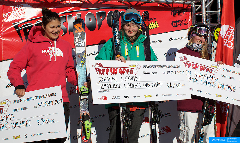 Devin Logan, USA, (centre) winner of the Women's Halfpipe Finals, with Amy Sheehan, New Zealand (right), second place, and Janina Kuzma, New Zealand, (left) third place, during The North Face Freeski Open at Snow Park, Wanaka, New Zealand, 3rd September 2011. Photo Tim Clayton...