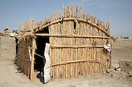 Home of a Marshland Arab family in Rota Village, one of the communities recieving funding from Coaltaton troops to stop the flow of weapons and insurgents in Iraq who come in across border with Iran