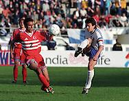05.06.1999, Olympic Stadium, Helsinki, Finland.  UEFA European Championship 2000 Qualifying match, Finland v Turkey..Jari Litmanen (Finland) v Ali Eren (Turkey).©JUHA TAMMINEN