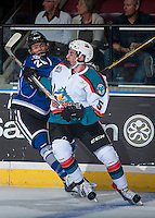 KELOWNA, CANADA - SEPTEMBER 3: Konrad Belcourt #5 of Kelowna Rockets is checked by Dino Kambeitz #26 of Victoria Royals on September 3, 2016 at Prospera Place in Kelowna, British Columbia, Canada.  (Photo by Marissa Baecker/Shoot the Breeze)  *** Local Caption *** Konrad Belcourt; Dino Kambeitz;