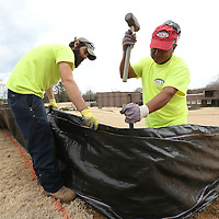 Adam Robison | BUY AT PHOTOS.DJOURNAL.COM<br /> Bernard Latusa and Erick Morlina, both from Slidell Louisiana and employees for RCI construction, install a slik fence on the grounds of the Elvis Presley Birthplace where work started on the phase 3 construction Tuesday morning in Tupelo.
