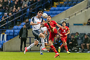 Joe Walsh of MK Dons high challenge on Daryl Murphy of Bolton Wanderers during the EFL Sky Bet League 1 match between Bolton Wanderers and Milton Keynes Dons at the University of  Bolton Stadium, Bolton, England on 16 November 2019.