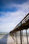 Long exposure landscape of pier and clouds in Outer Banks, North Carolina