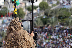 October 21, 2016 - Gaza City, Gaza Strip, Palestinian Territory - Palestinian Islamic Jihad militant takes up a position on a roof during a rally marking the 29th anniversary of the movement foundation in Gaza City October 21, 2016  (Credit Image: © Mohammed Asad/APA Images via ZUMA Wire)