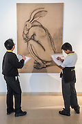 Pupils from Charlton Manor Primary School (with Crouching Figur by Sophie Ryder)- one of 10 sustainable legacy projects to receive funding from Captain Planet Foundation as part of It's Our World - It's Our World Auction in support of The Big Draw and Jupiter Artland Foundation, Chrisites, London, UK - Over 40 leading artists including David Hockney, Sir Antony Gormley, David Nash, Sir Peter Blake, Yinka Shonibare, Sir Quentin Blake, Emily Young and Maggi Hambling have committed artworks to the be sold at on 10 March 2016. The Auction is the culmination of a mass participation environmental arts project, promoting sustainability for future generations through art. Money raised will support The Big Draw, an arts education charity that works across the UK to promote visual