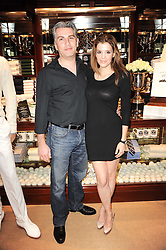 Linda Papadopoulos and her husband THEO PITSILLIDES at the Ralph Lauren Wimbledon Party held at Ralph Lauren, 1 New Bond Street, London on 17th June 2010.