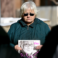 Judy Silk holds a picture of her sister-in-law, Jamie Lee Wounded Arrow outside of the Minnehaha County Courthouse in Sioux Falls on Tuesday, Jan. 10, 2017. Jamie Lee Wounded Arrow, 28, was found dead in her Sioux Falls, S.D., apartment last Friday. Today was a hearing for the perpetrator, Joshua Rayvon LeClaire. Judge set bond at $1 million.