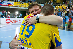 Fredi Radojkovic, head coach of Cimos Koper and Robert Konecnik of Cimos Koper celebrate after the 1st Leg handball match between RK Cimos Koper and BM Atletico Madrid (ESP) in Quarterfinals of EHF Champions League 2011/2012, on April 21, 2012 in Arena Bonifika, Koper, Slovenia.  Cimos Koper defeated Atletico Madrid 26-23. (Photo by Vid Ponikvar / Sportida.com)