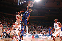 Memphis' Rodney Carney dunks over the opposition during the Coaches vs Cancer Classic held at Madison Square Garden in New York, NY.  (Mandatory Credit: Delane B. Rouse/ContrastPhotography.com)