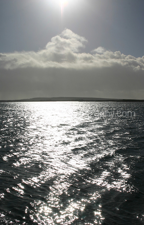 Seascape from Inis Mor the Aran Islands, Connemara, County Galway, Ireland. Sunlight reflecting on the atlantic sea.