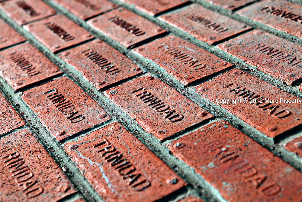 SHOT 1/1/12 3:36:36 PM - Personalized bricks that line the streets of Trinidad, Co. Nestled against the foothills of the Rocky Mountains halfway between Santa Fe and Denver, Trinidad retains its Old West character and the vitality of its pioneering days on the Santa Fe Trail. Visitors find gracious parks among winding brick streets and broad avenues. A wealth of historic architecture and outstanding history, art history, and archaeological museums depict how the West was once.(Photo by Marc Piscotty /  © 2012)