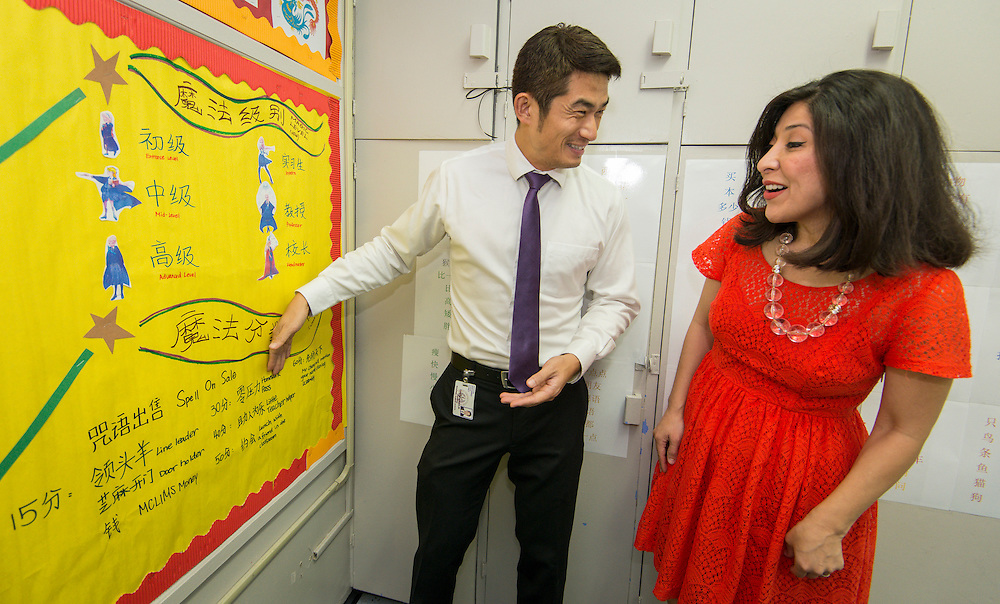 Chaolin Chang, left, explains a project to Houston ISD board of trustees president Juliet Stipeche at the Mandarin Chinese Language Immersion Magnet School, September 12, 2014.