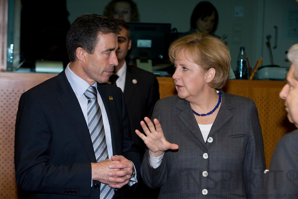BRUSSELS - BELGIUM - 12 DECEMBER 2008 -- EU Summit under the French Presidency -- Angela MERKEL,  Federal Chancellor of Germany and the Danish Prime Minister Anders Fogh RASMUSSEN, having an conversation before the beginning of the second meeting day. Photo: Erik Luntang