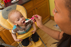 Toddler being fed. (This photo has extra clearance covering Homelessness, Mental Health Issues, Bullying, Education and Exclusion, as well as the usual clearance for Fostering & Adoption and general Social Services contexts,)