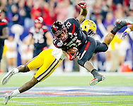 Dec 29, 2015; Houston, TX, USA; Texas Tech Red Raiders running back DeAndre Washington (21) is tackled by LSU Tigers cornerback Kevin Toliver II (2)  in the second quarter at NRG Stadium. Mandatory Credit: Thomas B. Shea-USA TODAY Sports