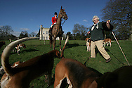 A hunter and a supporter of the Wynnstay Hunt assemble before the hunt rides out for a day's foxhunting. The Wynnstay Hunt, named after Sir Watkin Williams-Wynn, dated back to the 18th century and hunted on country estates in Shropshire, Cheshire and north Wales. Hunting with dogs in England and Wales became illegal on 18th February 2005 despite legal challenges to the ban and many hunts vowed to continue the ancient sport of foxhunting, risking prosecution.
