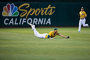 Oakland Athletics left fielder Matt Joyce (23) dives for a ball against the Los Angeles Angels at Oakland Coliseum in Oakland, California, on September 5, 2017. (Stan Olszewski/Special to S.F. Examiner)