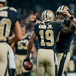 Sep 9, 2018; New Orleans, LA, USA; New Orleans Saints quarterback Drew Brees (9) celebrates with wide receiver Ted Ginn Jr. (19) during the first half of a game against the Tampa Bay Buccaneers at the Mercedes-Benz Superdome. Mandatory Credit: Derick E. Hingle-USA TODAY Sports