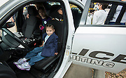 Students check out a Houston Police Department car at the When I Grow Up fair, March 8, 2014.