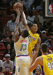 March 1, 2018 - Miami, FL, USA - The Miami Heat's Bam Adebayo (13) blocks a shot by the Los Angeles Lakers' Kyle Kuzma during the first quarter at the AmericanAirlines Arena in Miami on Thursday, March 1, 2018. The Lakers won, 131-113. (Credit Image: © David Santiago/TNS via ZUMA Wire)