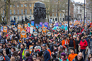 UNITED KINGDOM, London: 04 March 2018 Thousands of supporters march past the Monument to the Women of World War II on Whitehall during the #March4Women rally through London this afternoon. Thousands of people marched from Parliament to Trafalgar Square to celebrate International Women's Day and 100 years since the first women in the UK gained the right to vote. <br /> Rick Findler / Story Picture Agency