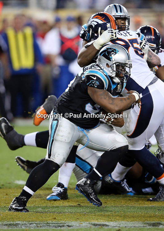 Carolina Panthers running back Jonathan Stewart (28) runs the ball for a gain of 1 yard late in the fourth quarter during the NFL Super Bowl 50 football game against the Denver Broncos on Sunday, Feb. 7, 2016 in Santa Clara, Calif. The Broncos won the game 24-10. (©Paul Anthony Spinelli)