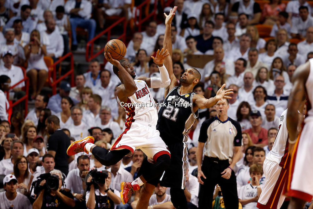 Jun 9, 2013; Miami, FL, USA;  Miami Heat shooting guard Dwyane Wade (3) shoots against San Antonio Spurs power forward Tim Duncan (21) during the third quarter of game two of the 2013 NBA Finals at the American Airlines Arena. Mandatory Credit: Derick E. Hingle-USA TODAY Sports