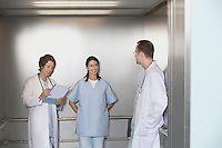 Physicians in Elevator talking