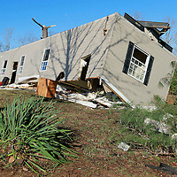 Thomas Wells   BUY AT PHOTOS.DJOURNAL.COM<br /> A mobile home rests upside down in the Three Forks Community near Wanut in Benton County on Monday as work continues to clean up the area following last weeks tornado.
