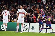 Barcelona's Pedro Fernandez celebrates with Toure Yaya and Lionel Messi as VfB Stuttgart Sami Khedira and Georg Niedermeier look dejected during their Champions League March 17, 2010.  Camp Nou, Barcelona.