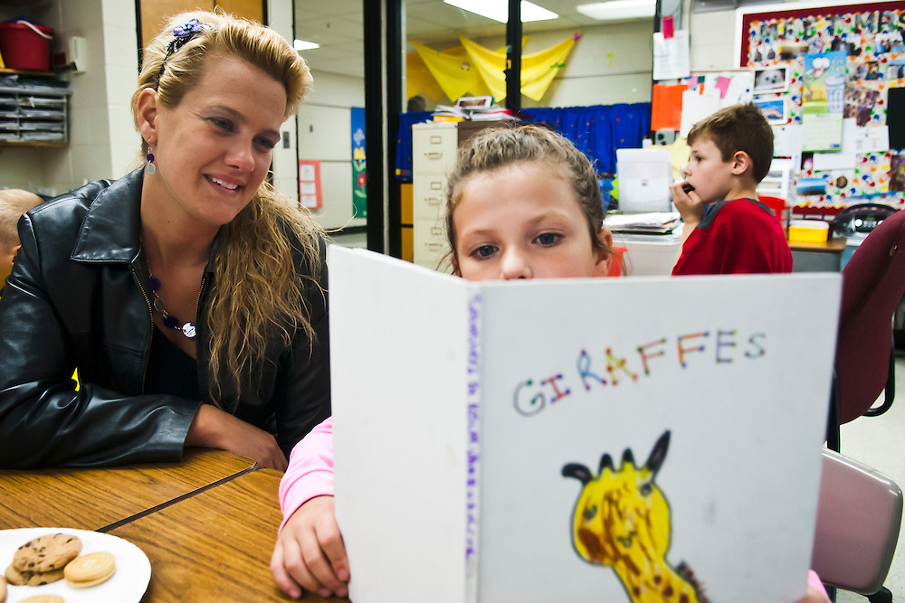 Lathan Goumas   MLive.com..Kelee VanBruskirk, 7, reads a book she wrote to her mother Aprilduring the seventh annual Author's Tea at Cool Elementary School in Grand Blanc Township, Mich. on Friday June 1, 2012. The event allows students to invite members of their family to the school and share with them a book of each student has written during the year.
