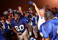 Demopolis High School trainer Don Sprewell celebrates with the team as Ray Williams (60) yells following the team's 14-0 win against Thomasville in Demopolis, Alabama, Nov. 19, 2004. (Photo by Carmen K. Sisson/Cloudybright)