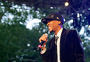 Igmar Thomas speaks during the 75th Anniversary of Blue Note Records concert in association with Revive Music celebrating 15 years of Okayplayer at SummerStage in Rumsey Playfield in New York City, NY on August 3, 2014.