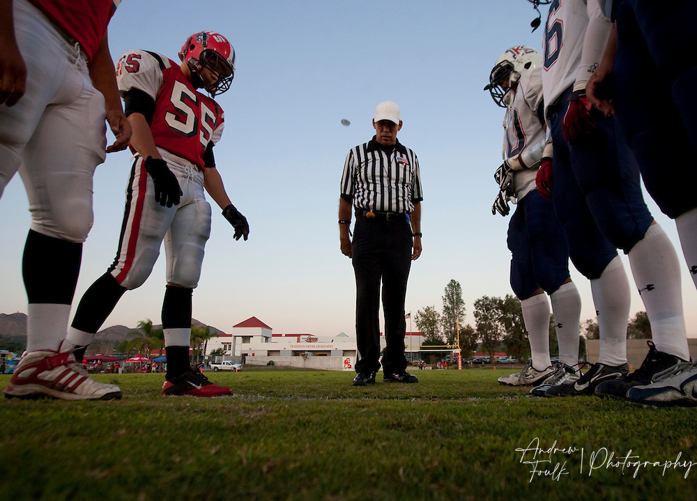 /Andrew Foulk/ For The Californian/.Lake Elsinore and King players line up for the coin toss.