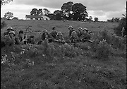 """Army Exercises In Co Sligo.   (L37).<br /> 1977.<br /> 05.09.1977.<br /> 09.05.1977.<br /> 5th September 1977.<br /> The Army Reserve Brigade, which is made up of regular units from the Southern Command, are conducting a series of conventional military exercises in counties Mayo and Sligo from the 5th to the 9th September. Approximately 1,500 men and 250 vehicles are involved. The exercise was codenamed """"Humbert"""" after an ill fated expedition by French troops into Ireland on 23rd August 1798. 1,100 French troops with Irish support took on the incumbent English forces. After some initial success they were defeated at Ballinamuk on 8th Sept 1798 by the army of Cornwallis.<br /> <br /> Members of the 4th Infantry batallion are pictured taking up defensive positions during the exercise.<br /> (L-R). Pte Wayne O'Connor,Pte Francis Wyse, Corp Dan Downey,Corp Paddy Hartnell, Pte Patrick Deasy,Pte Patrick Mahoney, Pte Colin O'Brien,Pte Gerry Fogarty,Pte Billy Collins, Pte Derry Hegarty and Corp Ger Sheehan."""