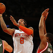 J.R. Smith, New York Knicks, drives to the basket during the New York Knicks vs Milwaukee Bucks, NBA Basketball game at Madison Square Garden, New York. USA. 15th March 2014. Photo Tim Clayton