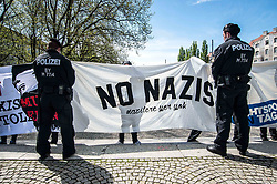 May 6, 2017 - MüNchen, Bayern, Germany - Police look at banners held up by peaceful student protestors.  On a Saturday morning in the Schwabing area of Munich the AfD held a demonstration/information stand.  In protest, numerous children arrived to stand up against the far-right, anti-democratic politics of the AfD, whose Bavarian head, Petr Bystron, was recently revealed to be under Verfassungsschutz (secret service) monitoring due to his support for and activities with far- to radical-right extremist groups (Credit Image: © Sachelle Babbar via ZUMA Wire)