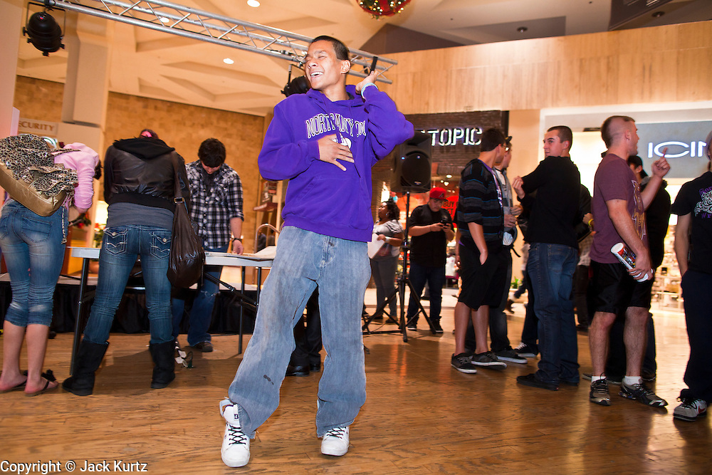 """25 NOVEMBER 2011 - PHOENIX, AZ:   Kyle Dela Rose (CQ), a member of the wrestling team at North Canyon High School, break dances in the center courtyard at Paradise Valley Mall Friday morning. """"Black Friday,"""" the unofficial start of the holiday shopping season started even earlier than normal. Many stores, including Target and Best Buy, opened at midnight.    Photo by Jack Kurtz"""