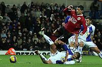 Photo: Paul Thomas.<br /> Blackburn Rovers v Manchester United. The Barclays Premiership. 11/11/2006.<br /> <br /> Blackburn's Tugay(Bottom) tackles Cristiano Ronaldo.