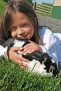 Seven-year old Madisson Foster enjoys some time with her Satin.rabbit, Bun-Bun.