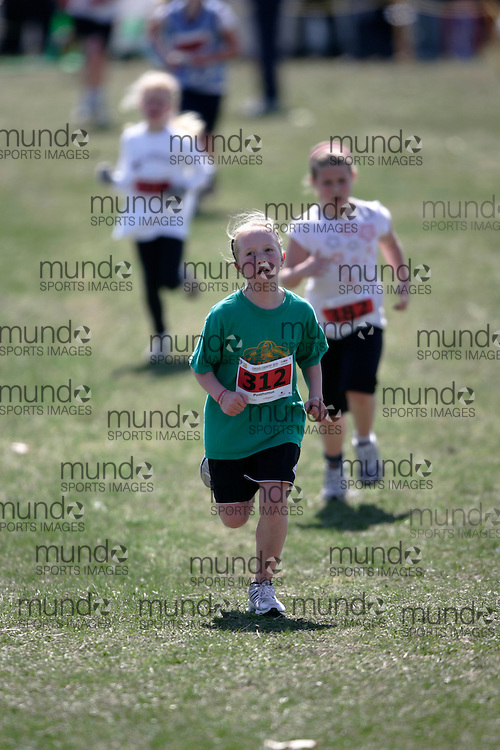 (Kingston, Canada---11 April 2010) Leslie Posthumus (#312) of Lord Strathcona PS runs in the Elementary Girls race at the 17th World University Cross Country Championships (FISU) held on the Fort Henry Hill course in Kingston, Ontario, Canada. .Geoff Robins/ Mundo Sport Images..This photograph is Copyright Geoff Robins / Mundo Sport Images, 2010. For information, go to www.mundosportimages.com or contact info@mundosportimages.com.