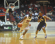 """Mississippi guard Chris Warren (12) is defended by Alcorn State's Alex Savannah (3) at the C.M. """"Tad"""" Smith Coliseum in Oxford, Miss. on Thursday, December 29, 2010. (AP Photo/Oxford Eagle, Bruce Newman)"""