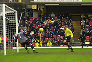 28/02/2004  -  Nationwide Div 1 Watford v Wimbledon.Watford's Neal Ardley slots in Watford's fourth goal as the ball goes over, Steve Banks,  Wimbledon keepers head. .
