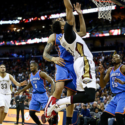 Feb 25, 2016; New Orleans, LA, USA; New Orleans Pelicans forward Anthony Davis (23) shoots over Oklahoma City Thunder center Steven Adams (12) during the second half of a game at Smoothie King Center. The Pelicans defeated the Thunder 123-119. Mandatory Credit: Derick E. Hingle-USA TODAY Sports
