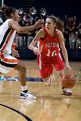 Davidson guard Alexandra Thompson (10) dribbles past Virginia guard Sharnee Zoll (5).  The Virginia Cavaliers women's basketball team defeated the Davidson Wildcats 83-68 at the John Paul Jones Arena in Charlottesville, VA on December 20, 2007.