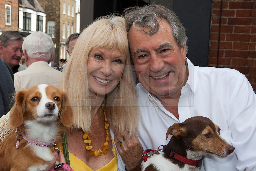 © under license to London News Pictures. 25/06/12..Fellow Python Terry Jones and actress Carol Cleveland outside The Angel Inn at the unveiling of a blue plaque to former Monty Python star, Graham Chapman. The memorial has been organised by Chapman's family, friends, and former colleagues, following the news that English Heritage have dropped plans for an 'official' Blue Plaque to the star, due to budget cuts...ALEX CHRISTOFIDES/LNP