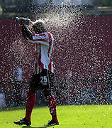 Nationwide Div 2 - Brentford v Hartlepool..Brentfords's Tony Rougier, spray's himself with the drinking bottle on a hot Sept. afternoon at Griffen Park.  © Peter Spurrier/Intersport-Images, email images@intersport-images.com. Mob +447973819551