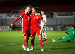 NEWPORT, WALES - Tuesday, October 16, 2018: Wales' Connor Evans celebrates scoring his teams second goal with Aaron Lewis during the UEFA Under-21 Championship Italy 2019 Qualifying Group B match between Wales and Switzerland at Rodney Parade. (Pic by Laura Malkin/Propaganda)